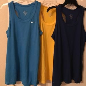 3 Nike exercise tops L